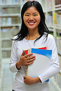 young asian student in library