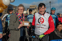 A Charity Bike Ride linking two Portobellos set off early this morning. A former Edinburgh Portobello resident Gordon Barclay left Portobello, Edinburgh to cycle to Portobello, London. The ride will raise funds for Clarrie Mendy, who tragically lost 2 relatives in the Grenfell Tower Disaster and has now been diagnosed with Motor Neurone Disease, and for Doddie Weir's MY NAME5 DODDIE foundation. Pictured: Maureen Child, (Portobello, Edinburgh councillor), Gordon Barclay with a letter from Portobello, Edinburgh to Portobello, London that Gordon will take with him and deliver on Friday when he gets to the other Portobello<br /> <br /> <br /> © Jon Davey/ EEm