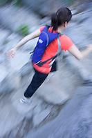 Young woman trail running near Emerald Bay. Lake Tahoe, CA