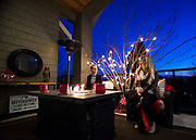 Visitors enjoy an outdoor patio space decorated for the Central Okanagan Hospice Association's Homes for the Holidays fundraiser in Kelowna, B.C. on Nov. 17, 2018.