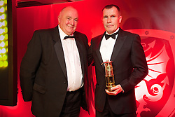 CARDIFF, WALES - Monday, October 6, 2014: FAW President Trefor Lloyd-Hughes presents Wales' outgoing women's manager Jarmo Matikainen with a special award at the FAW Footballer of the Year Awards 2014 held at the St. David's Hotel. (Pic by David Rawcliffe/Propaganda)