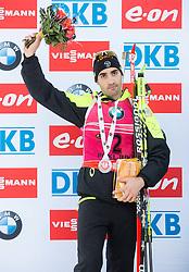 Second placed FOURCADE Martin (FRA) celebrates at medal ceremony after the Men 15 km Mass Start at day 4 of IBU Biathlon World Cup 2014/2015 Pokljuka, on December 21, 2014 in Rudno polje, Pokljuka, Slovenia. Photo by Vid Ponikvar / Sportida