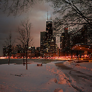 The Hancock Building stands tall in the Chicago skyline along Lake Shore Drive and Lake Michigan as a fresh snow cover the ground in February 2008. Photography by Jose More