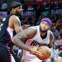 16 January 2016: Sacramento Kings center DeMarcus Cousins (15) drives past Los Angeles Clippers center Josh Smith (5) during the Sacramento Kings 110-103 victory over the Los Angeles Clippers, at the Staples Center, Los Angeles, California, USA.
