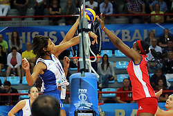Puerto Rico Ocasio Karina and Cuba Daymara Lescay Cajigal fight over the net