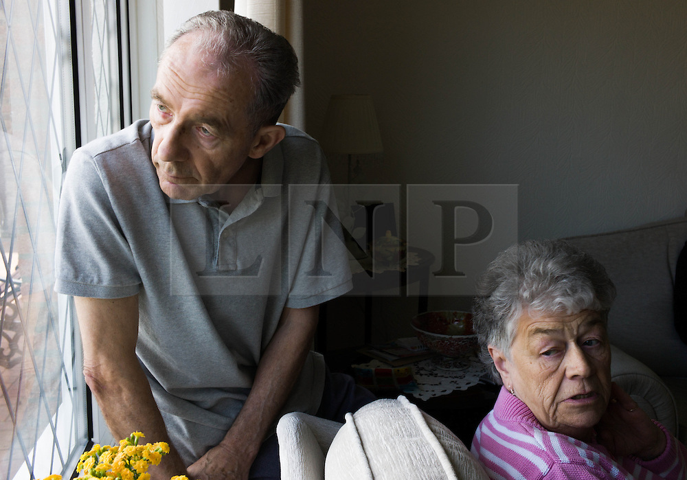 © Licensed to London News Pictures. 09/04/2014<br /> <br /> Durham, United Kingdom<br /> <br /> Parkinson's Disease sufferer David Forsyth from Brandon, County Durham and his wife Judy sit and look out of the window as they talk about his illness.<br /> <br /> Parkinson's is a long-term neurological condition that affects the way the brain co-ordinates body movements including walking, talking and writing and affects both men and women.<br /> <br /> Photo credit : Ian Forsyth/LNP