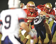 Lafayette High's Demarkous Dennis (5) runs vs. Lewisburg in Homecoming football action in Oxford, Miss. on Friday, September 30, 2011. Lafayette High won 42-0 for the team's 23rd straight win.