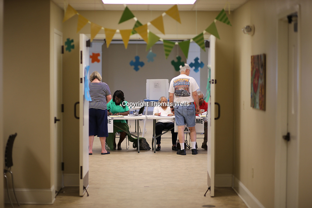 Tupelo Ward 3 residents sign in to before casting their ballots in Tuesday's General.
