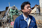 Michihiro Kohno, president and CEO of Yagisawa Shoten, stands by a press machine as he looks through the rubble that was once his 200-year-old soy sauce company's premises in Rikuzentakata, Iwate Prefecture Prefecture, Japan on 04 April 2011. Photograph: Robert Gilhooly