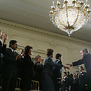 Pres. Bush walks with first lady Laura Bush after marking the first anniversary of the start of Operation Enduring Freedom in an East Room event Friday, March 19, 2004, in Washington, DC...Photo by Khue Bui