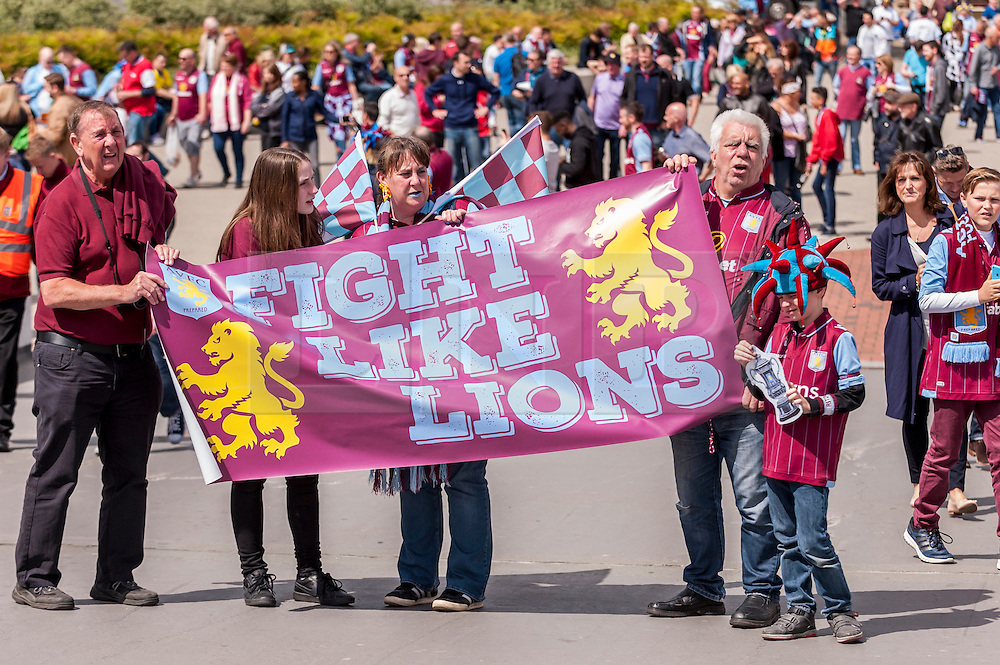 © Licensed to London News Pictures. 30/05/2015. London, UK. A family of Aston Villa supporters hold up a flag, as fans gather at Wembley Stadium for the FA Cup Final 2015, between Arsenal and Aston Villa. Photo credit : Stephen Chung/LNP