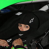 NASCAR Sprint Cup driver Danica Patrick prepares herself in her racecar during a NASCAR Daytona 500 practice session at Daytona International Speedway on Wednesday, February 20, 2013 in Daytona Beach, Florida.  (AP Photo/Alex Menendez)