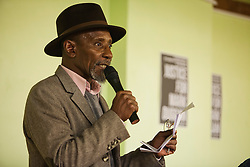 © Licensed to London News Pictures. 30/01/2014. London, UK. Poetry and singer Linton Kwesi Johnson attends during a public debate at North London Community Centre on Mark Duggan's trial. Photo credit : Andrea Baldo/LNP