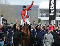 National Hunt Horse Racing - 2020 Cheltenham Festival - Wednesday, Day Two (Ladies Day)<br /> <br /> Winner, Davy Russell on Envoi Allen enters the winners enclosure in the 13.30 Ballymore Novices' Hurdle (Grade 1), at Cheltenham Racecourse.<br /> <br /> COLORSPORT/ANDREW COWIE