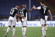 Juventus's Brazilian striker Douglas Costa celebrates with Brazilian defender Danilo and Juventus's Portuguese striker Cristiano Ronaldo after scoring to give the side a 3-0 lead during the Serie A match at Luigi Ferraris, Genoa. Picture date: 30th June 2020. Picture credit should read: Jonathan Moscrop/Sportimage