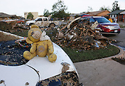 A nearly beheaded teddy bear sits rescued from the rubble of a tornado destroyed home in Moore, Oklahoma May 21, 2013. A massive tornado tore through a suburb of Oklahoma City, wiping out whole blocks and killing at least 24.   REUTERS/Rick Wilking (UNITED STATES)