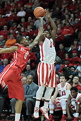 15 February 2014:  Bobby Hunter gets off a 3 pointer as Ka'Darryl Bell arrives during an NCAA Missouri Valley Conference (MVC) mens basketball game between the Bradley Braves and the Illinois State Redbirds  in Redbird Arena, Normal IL.