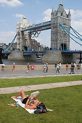 © licensed to London News Pictures. London, UK 25/07/2012. People sunbathing in Potters Fields Park on 25/07/12 in London. Photo credit: Tolga Akmen/LNP