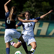 UNCW's Natalie Winslow battles for the ball with Longwood's Gina D'Orazio.