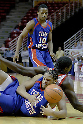 02 December 2006: Larry Posey works to wrangle the ball and knocks Greg Dilligard out of the way. In a non-conference game, the Mavericks of University of Texas at Arlington lost to the Redbirds home 86-61. The win was the 5th in a row for the Redbirds, the longest winning streak in 6 years. the game was played at Redbird Arena in Normal Illinois on the campus of Illinois State University.<br />