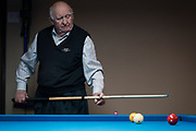 Bob Keller looks on after a shot during a game of billiards at Three Cushion Billiards in Madison, WI on Friday, May 10, 2019.