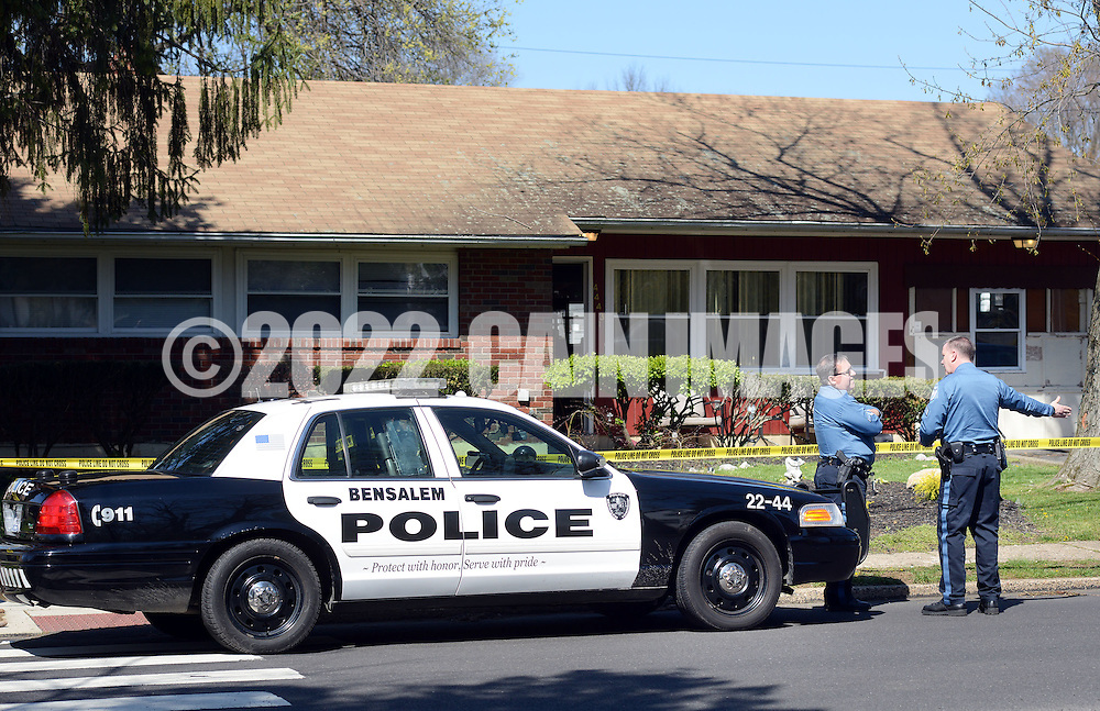 Police officers stand on scene after a 26 year old woman was shot Sunday, April 10, 2016 in Bensalem, Pennsylvania.  (Photo by William Thomas Cain)