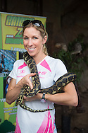 Liz Blatchford (GBR) handles some of the tropical North Queensland wildlife after official press conference of the 2013 Ironman Cairns Triathlon Festival. Cairns Wildlife Dome, Cairns, Queensland, Australia. 06/06/2013. Photo By Lucas Wroe