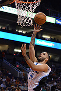 Mar 17, 2017; Phoenix, AZ, USA; Orlando Magic guard Evan Fournier (10) lays up the basketball against the Phoenix Suns in the first half of the NBA game at Talking Stick Resort Arena. Mandatory Credit: Jennifer Stewart-USA TODAY Sports