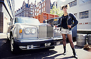 Kelly Standing with a Car, Coram Street,London, UK, 1980s.