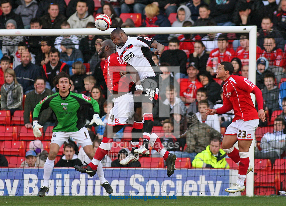 Barnsley - Saturday 21st February 2009 : Trésor Kandol of Charlton Athletic & Darren Moore of Barnsley in action during the Coca Cola Championship match at Oakwell, Barnsley. (Pic by Steven Price/Focus Images)