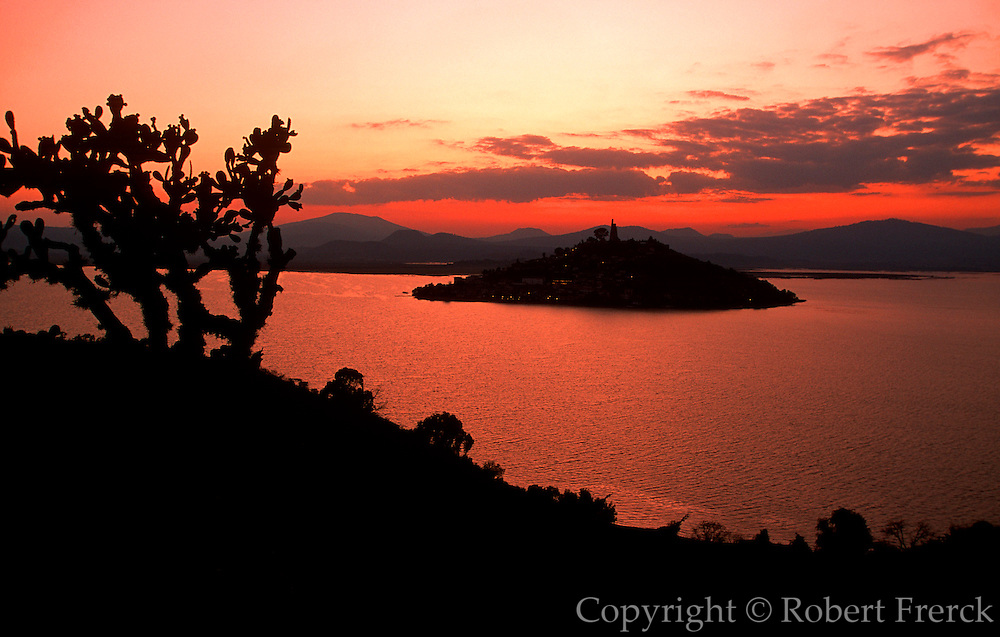MEXICO, MICHOACAN STATE, LANDSCAPE Island of Janitzio in Lake Patzcuaro with colossal statue of Morelos on its summit at sunset