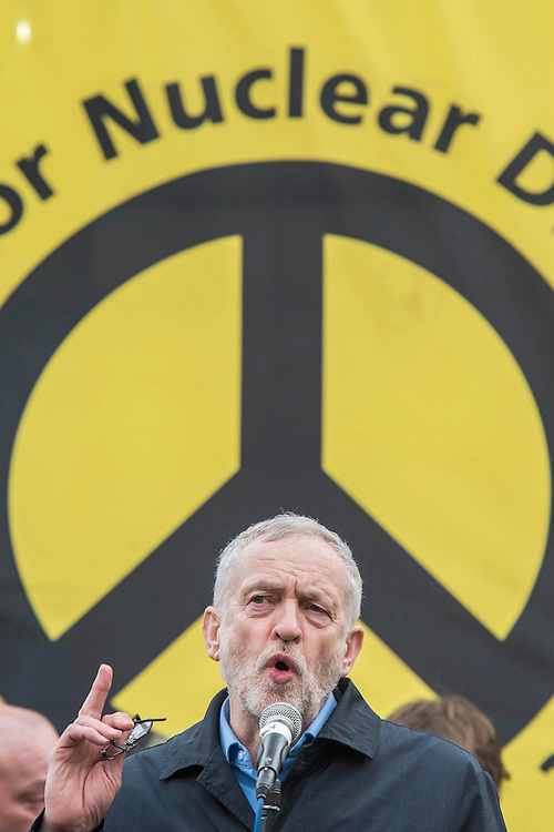"""Jeremy Corbin, the last speaker, adresses an enthusioastic audience - A CND led national demonstration to protest against Britain's nuclear weapons system: Trident. They state - """"The majority of the British people, including the Labour leader Jeremy Corbyn, oppose nuclear weapons. They are weapons of mass destruction, they don't keep us safe and they divert resources from essential spending."""" The march from Hyde park to Trafalgar Square was supported by Friends of the Earth, the Green party, Greenpeace, the PCS Union, the Quakers, the Stop the War Coalition, War on Want amongst amny others."""