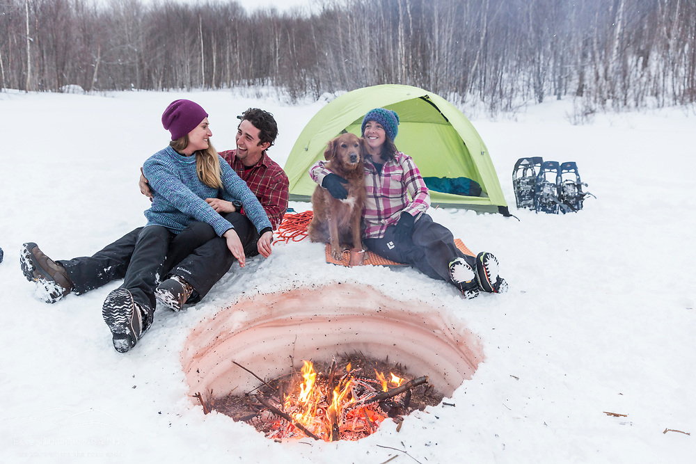 Three friends winter camping in New Hampshire's White Mountains. Randolph, NH.