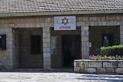 Israel, Upper Galilee, Metula, (founded 1896) is situated on the Lebanese boarder Renovated stone building one of the first houses to be built in the settlement in 1896. Now used as a first aid clinic