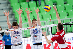 Mariusz Wlazly #10 of Poland and Tine Urnaut #13 of Slovenia during volleyball match between National teams of Slovenia and Poland in 4th Qualification game of CEV European Championship 2015 on May 23, 2014 in Arena Stozice, Ljubljana, Slovenia. Photo by Urban Urbanc / Sportida