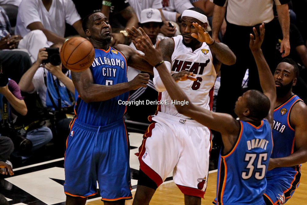 Jun 21, 2012; Miami, FL, USA; Miami Heat small forward LeBron James (6) passes the ball as Oklahoma City Thunder center Kendrick Perkins (5), small forward Kevin Durant (35), and guard James Harden (13) defend during the third quarter in game five in the 2012 NBA Finals at the American Airlines Arena. Mandatory Credit: Derick E. Hingle-US PRESSWIRE