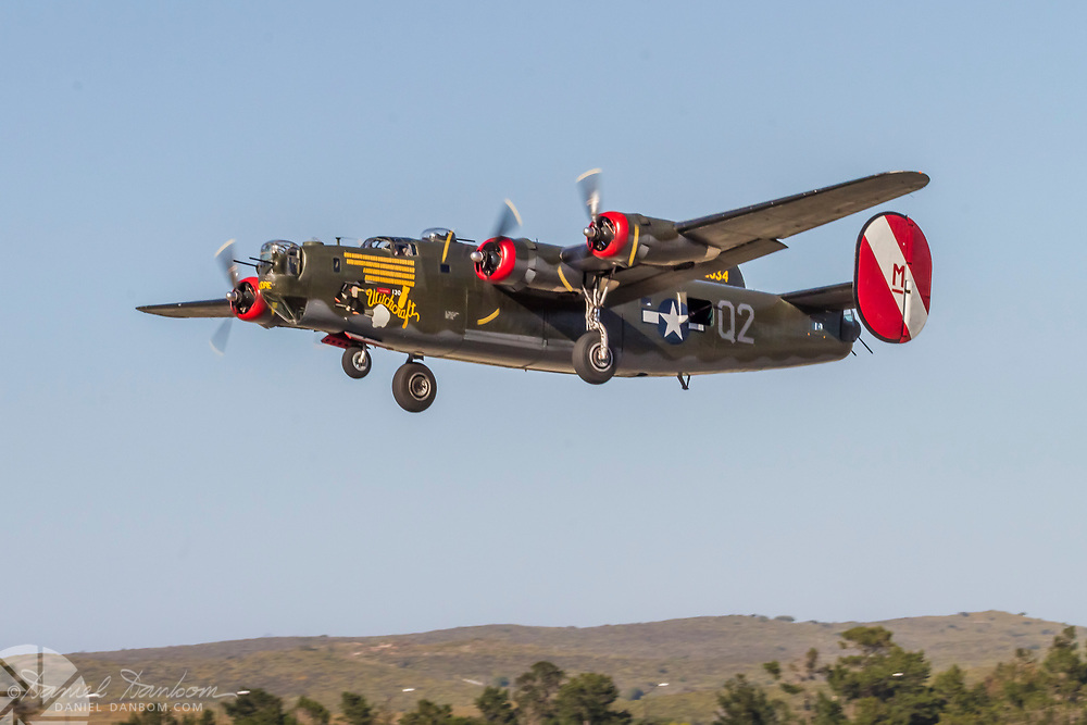 Consolidated B-24J Liberator, at Collings Foundation take off from Montery Jet Center, Monterey, California