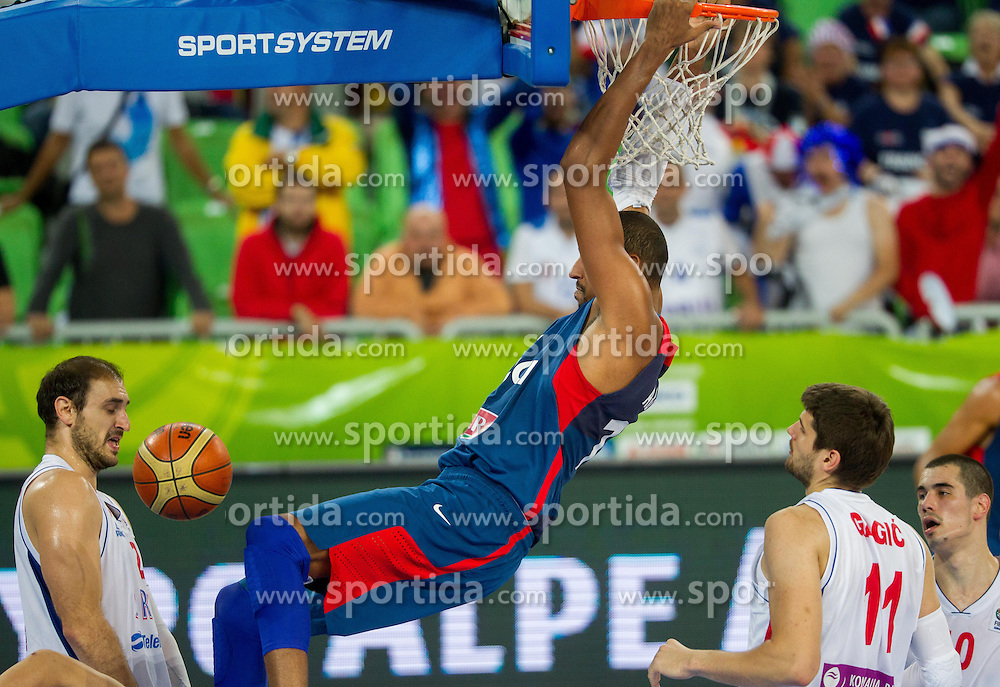 Nenad Krstic #12 of Serbia and Alexis Ajinca #14 of France during basketball match between National teams of Serbia and France in Round 2 at Day 12 of Eurobasket 2013 on September 15, 2013 in Arena Stozice, Ljubljana, Slovenia. (Photo by Vid Ponikvar / Sportida.com)