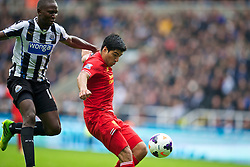 NEWCASTLE-UPON-TYNE, ENGLAND - Saturday, October 19, 2013: Liverpool's Luis Suarez is pulled back by Newcastle United's Mapou Yanga-Mbiwa for a penalty, the Newcastle player was then sent off, during the Premiership match at St. James' Park. (Pic by David Rawcliffe/Propaganda)