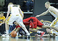 January 26, 2012: Nebraska Cornhuskers guard Toney McCray (0) eyes a lose ball between the legs of Iowa Hawkeyes forward Aaron White (30) during the NCAA basketball game between the Nebraska Cornhuskers and the Iowa Hawkeyes at Carver-Hawkeye Arena in Iowa City, Iowa on Thursday, January 26, 2012.