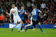 England defender Chris Smalling controls the ball during the Group E UEFA European 2016 Qualifier match between England and Estonia at Wembley Stadium, London, England on 9 October 2015. Photo by Alan Franklin.