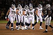 The Los Angeles Rams offensive line breaks fro the huddle during the 2018 regular season week 1 NFL football game against the Oakland Raiders on Monday, Sept. 10, 2018 in Oakland, Calif. The Rams won the game 33-13. (©Paul Anthony Spinelli)