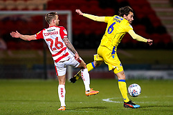 Edward Upson of Bristol Rovers takes on James Coppinger of Doncaster Rovers - Mandatory by-line: Robbie Stephenson/JMP - 26/03/2019 - FOOTBALL - Keepmoat Stadium - Doncaster, England - Doncaster Rovers v Bristol Rovers - Sky Bet League One