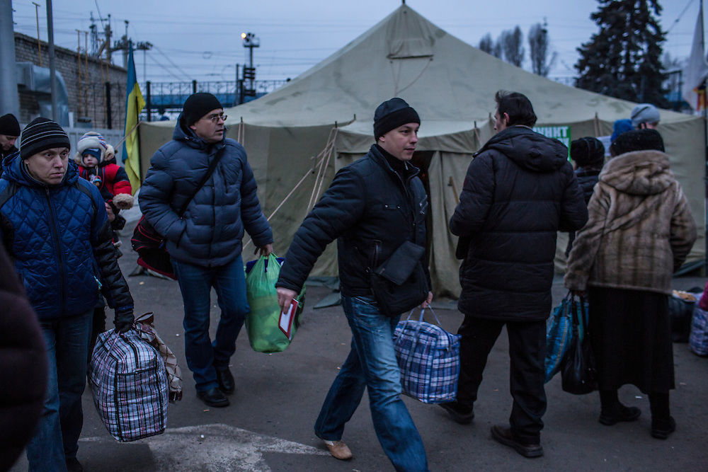 SLOVYANSK, UKRAINE - FEBRUARY 7, 2015: People displaced by fighting in the town of Debaltseve gather at the train station in Slovyansk, Ukraine. Many civilians have been evacuated from Debaltseve and brought to Slovyansk, where they are either given a free onward ticket or housed in a train until they can make further plans. CREDIT: Brendan Hoffman for The New York Times