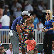 Jason Day, Australia, receives hugs and kisses from his son Dash and wife Ellie after winning the The Barclays Golf Tournament by six shots at The Plainfield Country Club, Edison, New Jersey, USA. 30th August 2015. Photo Tim Clayton