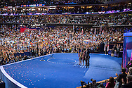 President Barack Obama, on stage with his family, waves after speaking at the Democratic National Convention on Thursday, September 6, 2012 in Charlotte, NC.