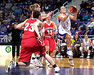 Kansas State guard Kimberly Dietz (R) drives to the basket for the score, past Nebraska defenders Kala Kuhlmann (C), Chelsea Aubry and Kelsey Griffin (23), late in the second half at Bramlage Coliseum in Manhattan, Kansas, February 7, 2007.  The Huskers defeated K-State 62-55.