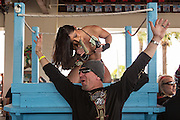 A biker celebrates at Froggies Bar with an exotic dancer during the 74th Annual Daytona Bike Week March 7, 2015 in Daytona Beach, Florida.