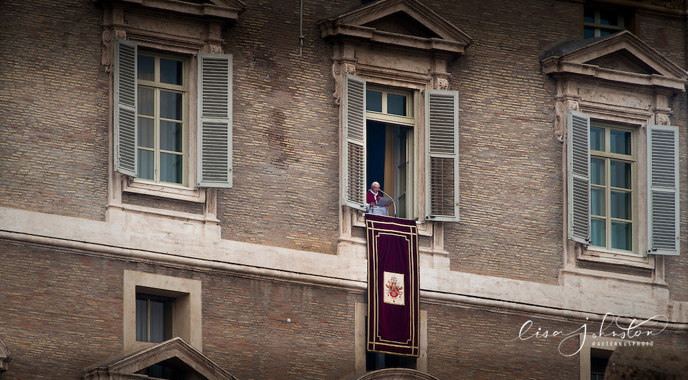 Pope Benedict XVI speaks from the window of his papal apartment as he gives his regular Sunday Angelus message to those in St. Peter's Square on the Solemnity of Mary Mother of God.