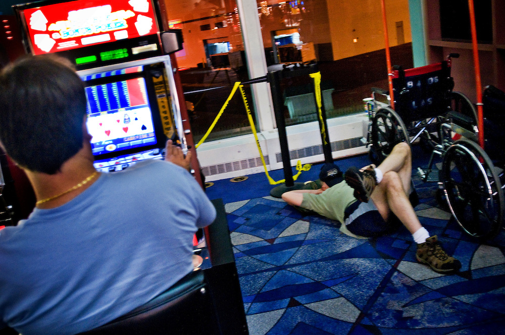 Man sleeping on the floor in Las Vegas McCarren Airport. .Photographer: Chris Maluszynski /MOMENT